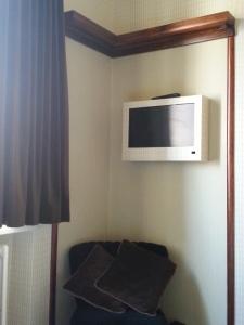 Kijkdoos in kamer Hotel Le Berger Brussel
