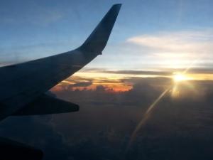 Ondergaande zon vanuit het Delta toestel
